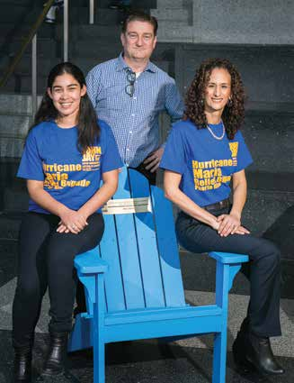 Declan Walsh, Director of Community Outreach and Service Learning (center) with Professor Gabriela Ramirez-Vargas (left) and Professor Jodie Roure (right)