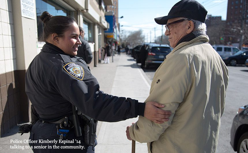Police Officer Kimberly Espinal '14 talking to a senior in the community.