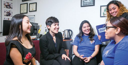 Carvajal (second from left) chatting with students in the new Immigrant Student Success Center.