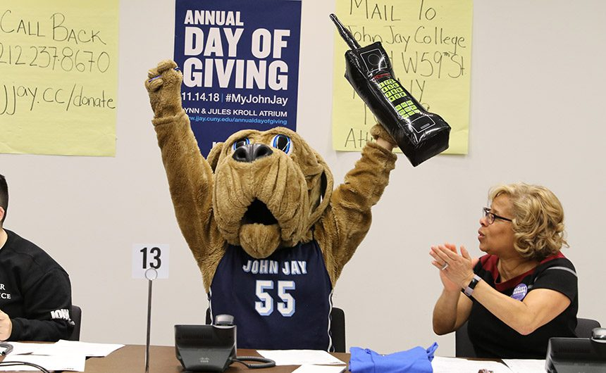 President Mason and Bloodhound mascot at the Annual Day of Giving